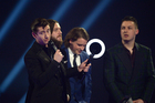 British band Arctic Monkeys accept the Best Album of the Year award at the 2014 BRIT Awards. Photo / AP
