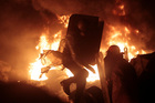 Anti-government protesters clash with riot police in Kiev's Independence Square, the epicenter of the country's current unrest. Photo / AP