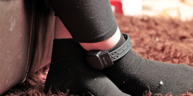 An electronic ankle bracelet monitors offenders on home detention. Photo / NZ Herald