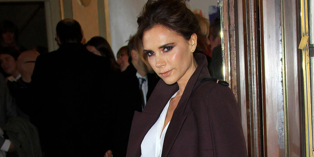 Victoria Beckham has admitted balancing her parenting duties with managing her clothing empire leaves her feeling 'constantly guilty'. Photo / AP