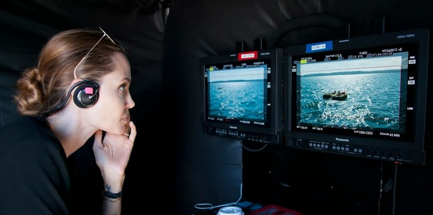 Loading Angelina Jolie on the set of her new movie, Unbroken.