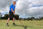 Mark Du Plessis relaxes on the golf course.