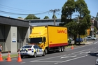 The CourierPost truck had its back tray down as it reversed and pinned the woman against a wall. Photo / Chris Loufte