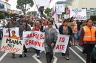 More than 200 people marched through Kaikohe yesterday. Photo / Peter de Graaf