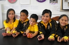 Anahera Fotulii (Year-3 total immersion), Akuhata Wiringi (Year- 4 total immersion), Josiah Tawa (Year-1 total immersion), Waiatatia Ratana-Karehana (Year-5) and Amoe Harawira (Year-3) with a selection of the summer Fruit in Schools which started on Monday.  Photo/Merania Karauria