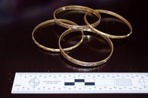 Police would like to hear of any sightings  of the gold bangles and the distinctive pendant taken off the victim during the assault. Photo / Police