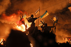 Monuments to Kiev's founders burn as anti-government protesters clash with riot police in Kiev's Independence Square. Photo / AP