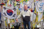 Mark Lowndes at the fence at end of the Freedom Bridge at the Korean Demilitarized Zone.