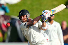 Brendon McCullum hits out during his record-breaking appearance in the second innings of the second test between New Zealand and India iN Wellington. Photo / Getty Images