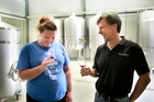 Winemaker Lauren Swift tests a sample with Chris Wilcock at the new Ash Ridge Bridge Pa Triangle winery. Photo/Warren Buckland