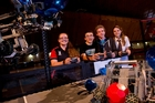From left: Niamh Conlon, Feilding High; Conor Thomas, Lynfield College, Logan Davy, Otumoetai College; and Jess Chase Long Bay College prepare for the robotics competition. Photo / Dean Purcell