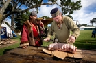 Kiwi Norsemen Franush Bloodaxe, Frank Kirkham, left, and Griff prepare the meat at the Howick Military Tattoo.