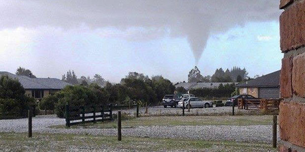 Loading A tornado can be seen in the skies above Leithfield, North Canterbury. Photo / Hurunui District Council