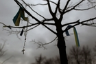 Rosary beads hang from a tree in Kiev's Independence Square, epicentre of Ukraine's unrest. Photo / AP
