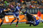 Blade Thomson is tackled during the Hurricanes' defeat to the Stormers. Photo / Getty Images