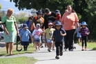 ON A MISSION: Children from Ko Te Aroha Children's Centre, Lakeview School and Te Kura Kaupapa Maori o Wairarapa take a walk to promote the new Slow Down signage in their neighbourhood.WTA280214ABSLOWDOWN0