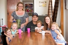 Stephanie Hawthorne (standing) - with Mark and Lara Utatao and children (from left) Esmae, Cleo, Frankie and Isla - has noticed attitudes to nannying services changing. Photo / Chris Loufte