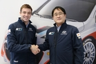 NZ Rally star Hayden Paddon, left, shakes hands with Gyoo-Heon Choi, president of Hyundai Motorsport.