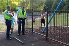 Police inspect a section of fence at Cornwall Park that injured a 3-year-old girl on Saturday. Photo/Duncan Brown