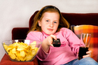 Kids eat a concerning amount of high sugar snacks while watching TV. Photo / Thinkstock