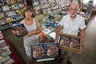 Poppies bookshop owners Pam and Breet Bennett, with copies of the fast-selling fundraising school cookbook at the Treachers Lane shop in Havelock North. Photo/Glenn Taylor