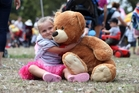 "Ariah Thorp gives her ""Big Bear'' a cuddle at the Western Springs event. Photo / Jason Oxenham"