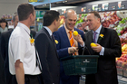 Tony Ryall sports a bright orange tie when visiting a Te Puke supermarket with John Key. Photo / BPT