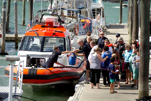 The coastguard assist people back to Westhaven after the Dolphin charter boat they were on started to sink in the Waitamata Harbour. Photo / Dean Purcell.
