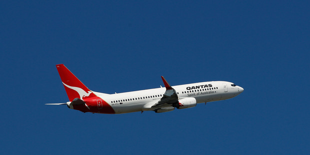 A Qantas jet takes off at Sydney Airport. The struggling airline is hoping that the Australian govt will change the law that restricts foreign ownership of the Australian airline. Photo / Bloomberg