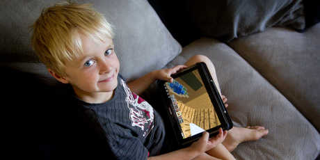 Harry Arden uses his father's tablet three or more times a week. Photo / Christine Cornege