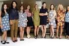 Designer Karen Walker with Sisters and Co boutique owner Rodelle Payne and staff before the Tauranga launch of her new range. Photo / George Novak