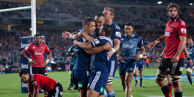 Super Rugby: Blues celebrate Jackson Willison's try against the Crusaders at Eden Park, Auckland. February 2014 New Zealand Herald Photograph by Richard Robinson.