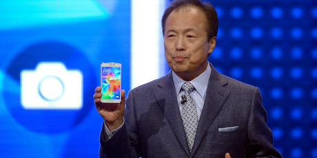 Samsung CEO J.K. Shin presents the new Samsung Galaxy S5 at the Mobile World Congress, the world's largest mobile phone trade show in Barcelona, Spain. Photo / AP