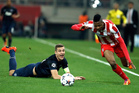 Olympiakos' Michael Olaitan right, goes for the ball as Manchester United's captain Nemanja Vidic looks on during their Champions League, round of 16, first leg soccer match. Photo / AP