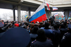 Pro-Russian demonstrators wave Russian flags during a protest in front of a local government building in Simferopol, Crimea, Ukraine. Photo / AP