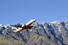 A jet takes off from Queenstown Airport.