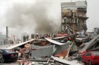 Police and volunteers work to rescue people trapped in the collapsed CTV building. Photo / File / APN