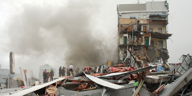 Police and volunteers work to rescue people trapped in the collapsed CTV building. Photo / APN