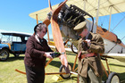 Lady Harriette Russell (Rosemary Smyth of Dannevirke) christens the BE.2c bi-plane as Major Forsyth-Jones of the Royal Flying Corps (David Nash of Napier) watches on. Photo/Duncan Brown