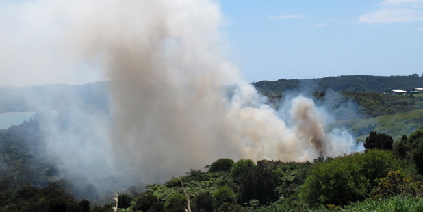 Smoke billows from bush and scrub at Redcliffs Rd during yesterday's fire.