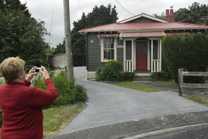 Coral Ferguson finds the solid old railway cottage where she grew up.