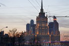 The Ukrainia hotel, where Viktor Yanukovych is said to be staying, is seen against the twilight Moscow sky. Photo / AP