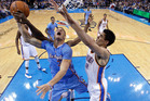 Steven Adams attempts to block a shot by Blake Griffin of the LA Clippers. Photo / AP