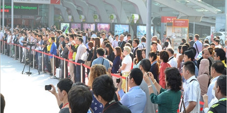 Visitors queue to enter the Canton Trade Fair.