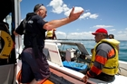 Coast Guard's Paul Fransham arranges to tow a troubled Auckland boatie back to Okahu Bay. Photo / Jason Oxenham.