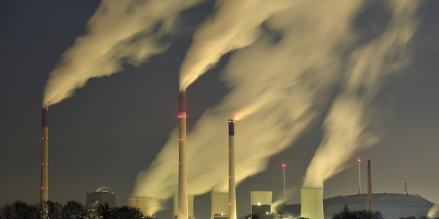 A treaty on emissions would change some things quickly, like the retirement of fossil fuel-burning power stations. Photo / AP
