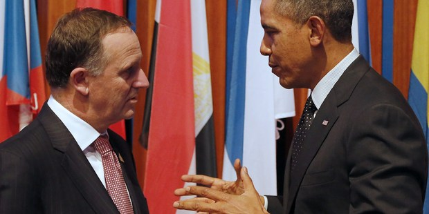 John Key and Barack Obama talk following the closing session of the Nuclear Security Summit in The Hague last year. Photo / Getty Images
