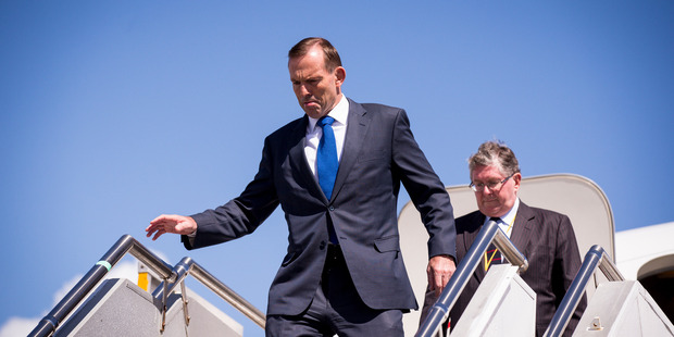 Australian Prime Minister Tony Abbott arrives at Auckland Airport on his first official visit to New Zealand. Photo / Dean Purcell