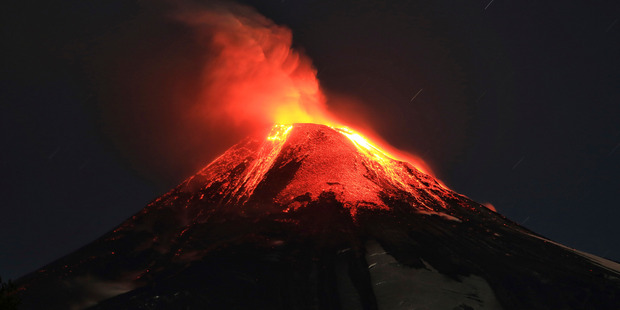 The 9,000 foot (2,847-metre) Villarrica volcano in Chile's central valley sits above the small city of Pucon, which has a population of about 22,000 people. Photo / AP