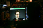 A video technician monitors a computer screen as National Security Agency whistle-blower Edward Snowden appears on a live video feed broadcast from Moscow. Photo / AP